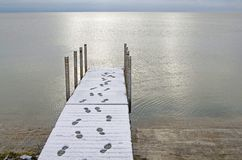 Footprints on Dock in Snow Stock Images