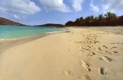 Footprints on an empty Caribbean beach. Royalty Free Stock Photography