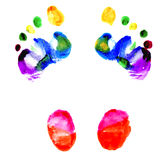 Footprints of feet painted in various colors. Footprints of feet painted in colors of the rainbow Royalty Free Stock Images