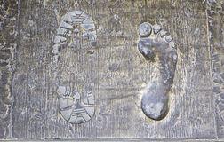 Footprints foot bronze Stock Image