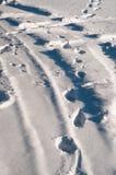 Footprints in fresh deep snow Royalty Free Stock Photos