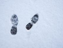 Footprints in fresh snow background. Top view Stock Photography