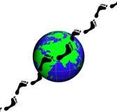 Footprints on globe earth Stock Photos