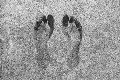Footprints on a gray concrete panel royalty free stock photography