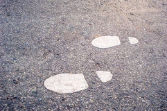 Footprints on the ground. Background royalty free stock photo