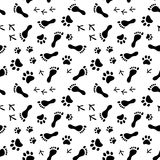 Footprints of human, cat, dog, birds black and white seamless pattern, vector Stock Photography