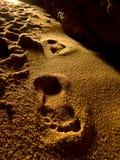 Footprints inside the cave. Coast of Algarve,Portugal Stock Image