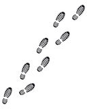 Footprints. Left and right footprints with clear pattern from the shoes of a person walking slowly, white background Stock Image