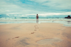 Footprints left by young woman on beach Stock Images