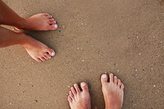 Footprints in love couple in the sand on the seashore Royalty Free Stock Photo