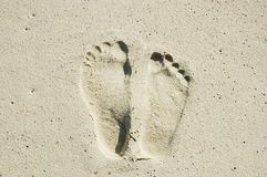 Footprints of lover. A man's left footprint and a woman's right footprint on the sand Stock Photo