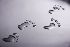 Footprints made from water Royalty Free Stock Photos