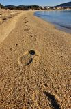 Footprints on Marina di Campo beach in march, Elba island. Footprints on Marina di Campo sandy beach, Elba island, in march. Tuscan archipelago, Italy Royalty Free Stock Photography