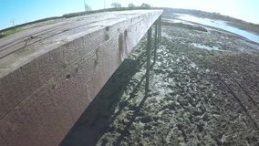 Footprints in mud of river. On wet river mud the footprints and tracks of the cross-country vehicle stock footage