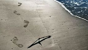 Footprints over sand Stock Photo
