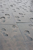 Footprints of people on the metal slabs Royalty Free Stock Photo