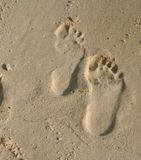 Footprints in the sand. Inverse footprints in the sand on the beach stock photography