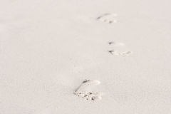 Footprints in the sand. Footprints in the soft sand royalty free stock photos