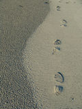 Footprints on the sand. A set of footprints embedded in the sand next to the beach Royalty Free Stock Image