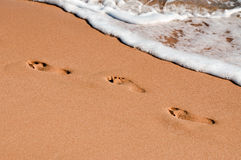 Footprints in the sand. By the sea Stock Image