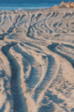 Footprints in the sand. Footprints in the sand tires, and people Royalty Free Stock Photo