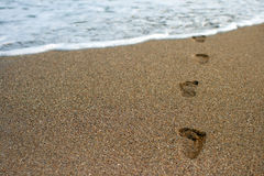 Footprints in a sand. Photo of footprints in a sandy beach stock photos