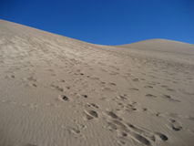 Footprints in sand. Footprints in the sand dunes stock images