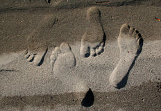 Footprints in the Sand. A pair of lover's footprints marks their passing until the next wave erases them royalty free stock images
