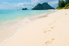 Footprints in the sand along the sea on Poda island. Thailand Stock Image