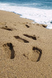 Footprints. In the sand on the beach stock image