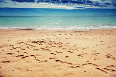 Footprints in the sand on the beach Stock Photos