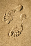 Footprints on the sand beach Royalty Free Stock Photo
