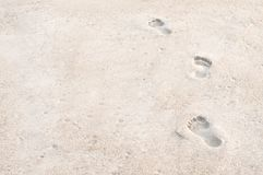 Footprints on the sand beach. Summer Vacation Stock Photos