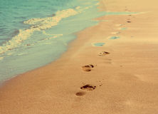 Footprints on sand beach - vintage retro style Stock Photos
