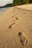 Footprints in the sand coron beach background. Footprints in the sand coron bay beach busuanga the philippines royalty free stock image