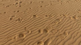 Footprints on sand dune, grains of sand, Corralejo, natural park. Fuerteventura. Royalty Free Stock Image