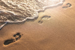 Footprints sand. Footprint on the beach before being deleted Royalty Free Stock Photo