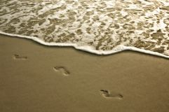 Footprints in the sand. stock photos
