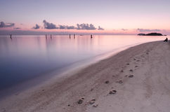 Footprints in the Sand. Human footprints in the sand of the beach that photograph during sunrise Royalty Free Stock Photos