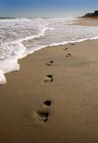 Footprints in the sand II. Footprints in the sand along the shore - An updated, more vivid version stock photos