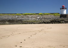 Footprints in the sand, Lighthouse, Burry Port Stock Photo
