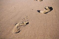 Footprints in the sand on Polzeath beach Vintage Retro Filter. Royalty Free Stock Photos