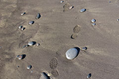 Footprints in the Sand. With stones Royalty Free Stock Photos