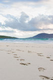 Footprints in the sand, turquise water and impressive skyes, Luskentyre, Isle of Harris, Scotland Stock Photo