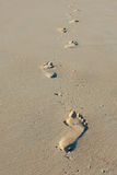 Footprints in sand. Walking alone - Footprints in the sand Stock Image