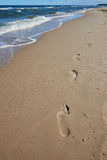 Footprints in sand. Footprints on the way Royalty Free Stock Photos