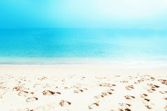 Footprints on sea shore. Sea water wave. Beach Vacation Royalty Free Stock Images