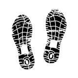 Footprints and shoeprints icon in black and white showing bare feet and the imprint of the soles with patterns of male. And female footwear. Shoes boots imprint Stock Photo