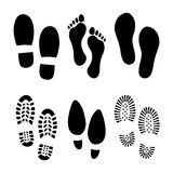 Footprints and shoes Royalty Free Stock Photos