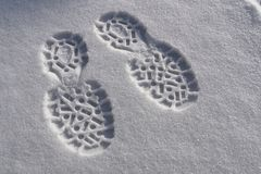 Footprints on the snow. Winter boots prints on the fresh snow royalty free stock photo